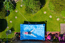 Limekilns, Scotland, UK. 20 May 2020. Fiona Philp (59) from Limekilns, Fife, a wild open water swimmer with the Fife Wild Swimmers group, during a daily dip in her garden pool. Many wild swimmers have been denied the opportunity to pursue their sport during Covid-19 lockdown and have purchased pools for their gardens to maintain their wellbeing. Iain Masterton/Alamy Live News