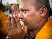 20 SEPTEMBER 2015 - SARIKA, NAKHON NAYOK, THAILAND: A Hindu priest blows a conch shell at the Ganesh festival at Shri Utthayan Ganesha Temple in Sarika, Nakhon Nayok. Ganesh Chaturthi, also known as Vinayaka Chaturthi, is a Hindu festival dedicated to Lord Ganesh. Ganesh is the patron of arts and sciences, the deity of intellect and wisdom -- identified by his elephant head. The holiday is celebrated for 10 days. Wat Utthaya Ganesh in Nakhon Nayok province, is a Buddhist temple that venerates Ganesh, who is popular with Thai Buddhists. The temple draws both Buddhists and Hindus and celebrates the Ganesh holiday a week ahead of most other places.    PHOTO BY JACK KURTZ