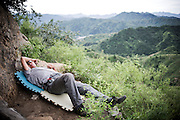 "A Chinese security guardian takes a rest in nature at the Great Wall touristic spot of Jinshanling near Beijing, China, July 22, 2014. <br /> <br /> This image is part of the series ""24/7"", an ironic view on restless and fast-growing Chinese economy described through street vendors and workers sleeping during their commercial daily activity. <br /> <br /> © Giorgio Perottino"