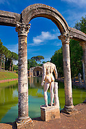 Statues and columns that surround a rectangular basin that ends at The Serapaeum, dedicated to the gods Isis and Serpis which was probably used as a banqueting hall. Hadrian's Villa ( Villa Adriana ) built during the second and third decades of the 2nd century AD, Tivoli, Italy. A UNESCO World Heritage Site. .<br /> <br /> If you prefer to buy from our ALAMY PHOTO LIBRARY  Collection visit : https://www.alamy.com/portfolio/paul-williams-funkystock/hadrians-villa-tivoli.html<br /> Visit our CLASSICAL WORLD HISTORIC SITES PHOTO COLLECTIONS for more photos to buy as buy as wall art prints https://funkystock.photoshelter.com/gallery-collection/Classical-Era-Historic-Sites-Archaeological-Sites-Pictures-Images/C0000g4bSGiDL9rw