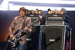 © Licensed to London News Pictures . FILE PICTURE DATED 30/06/2012. Manchester, UK. The Stone Roses are to headline at the 2013 Isle of Wight Festival organisers have announced today (26th November 2012). Pictured: Mani ( Gary Manny Mounfield ) of The Stone Roses, performs with the Stone Roses at Heaton Park in Manchester , for their Second Coming event in June 2012 . Photo credit : Joel Goodman/LNP