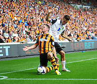 Hull City's Robbie Brady is fouled by Norwich City's Ricky van Wolfswinkel<br /> <br />  (Photo by Chris Vaughan/CameraSport) <br /> <br /> Football - Barclays Premiership - Hull City v Norwich City - Saturday 24th August 2013 - Kingston Communications Stadium - Hull<br /> <br /> © CameraSport - 43 Linden Ave. Countesthorpe. Leicester. England. LE8 5PG - Tel: +44 (0) 116 277 4147 - admin@camerasport.com - www.camerasport.com