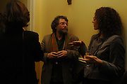 Craig Raine and  Eleni Mealagro. Book party for 'Saturday' by Ian McEwan, Polish Club, South Kensington.  4 February 2005. ONE TIME USE ONLY - DO NOT ARCHIVE  © Copyright Photograph by Dafydd Jones 66 Stockwell Park Rd. London SW9 0DA Tel 020 7733 0108 www.dafjones.com