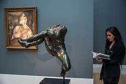"© Licensed to London News Pictures. 28/01/2016. London, UK.   (L to R) ""Pregnant Girl"" by Lucian Freud (est. £7-10m) and ""Iris, Messagère des dieux"" by Auguste Rodin (est. £6-8m), on display at Sotheby's preview of its upcoming Impressionist, Modern & Surrealist art sale on 3 February featuring works by some of the most important artists of the 20th century.  The combined total of the evening sale is expected to exceed £100m. Photo credit : Stephen Chung/LNP"