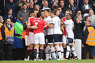 Memphis Depay of Manchester United squares up to Dele Alli of Tottenham Hotspur as both teams try to break it up. Barclays Premier league match, Tottenham Hotspur v Manchester Utd at White Hart Lane in London on Sunday 10th April 2016.<br /> pic by John Patrick Fletcher, Andrew Orchard sports photography.