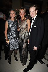 Left to right, CARLA BAMBERGER and The EARL & COUNTESS OF DERBY at the Cartier Racing Awards 2009 held at Claridge's, Brook Street, London on 17th November 2009.