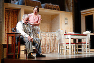 Photograph of actors George Sanchez & Mary Pauley portray Willie & Linda Loman in Le Petit Theatre's performance of Death of a Salesman in New Orleans, LA.