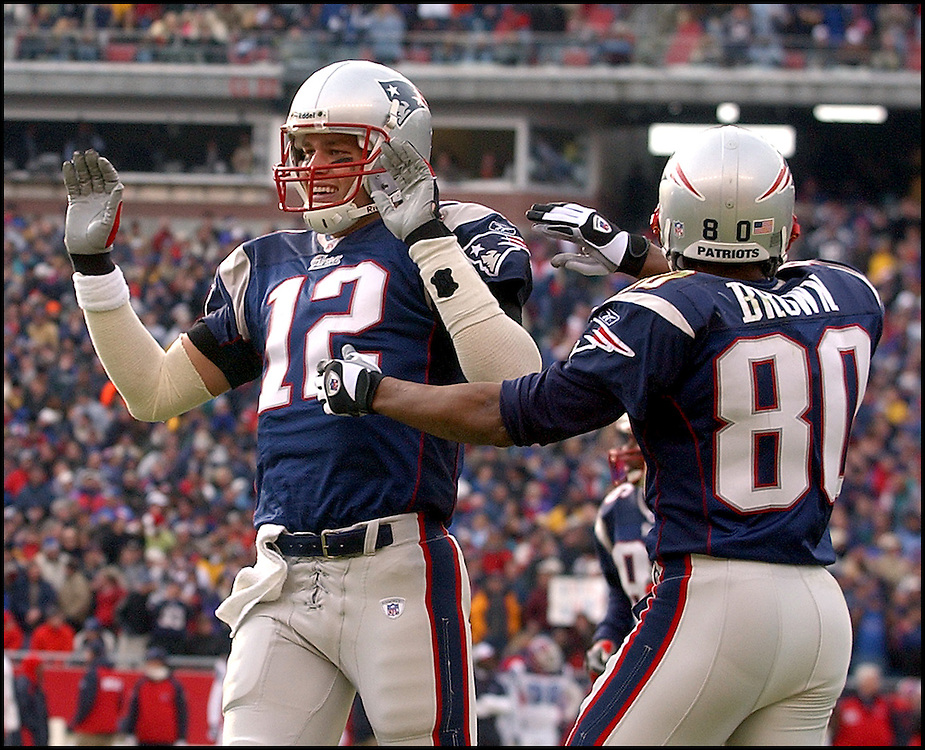 (12/8/02 Foxboro, MA) New England Patriots vs Buffalo Bills.  Tom Brady gets a high five from Troy brown and the sideline after his 1st Q TD pass to David Patten.  (120802patsmjs-staff photo  by Michael Seamans. Saved in photoMon/cd. )