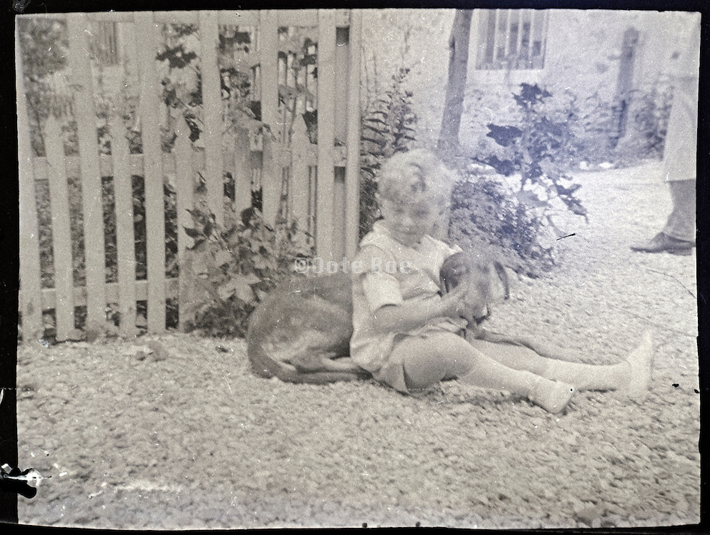 vintage image of boy with pet dog