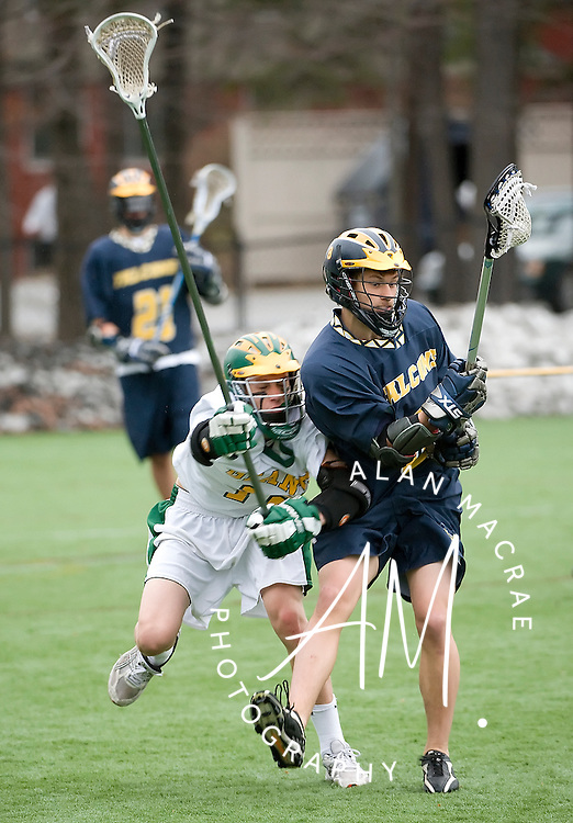 Bishop Brady's Doug Rosenberg chases Bow's [8 B. Gut] in Friday's game at Southern New Hampshire University.  (Alan MacRae/for the Monitor)