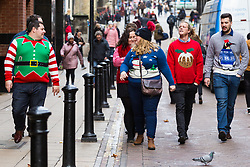 A group in Christmas jumpers make their way along Villiers Street in London's west end. London, December 21 2018.