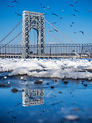 The double-decked suspension George Washington Bridge connects the New York City Manhattan borough with Fort Lee of the New Jersey borough over the Hudson River.