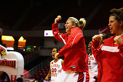 31 December 2006: Ashley Sandstead and others on teh Redbird becnh react to the play. The Bulldogs of Drake University dropped a conference match-up to the Redbirds 64-50 at Redbird Arena in Normal Illinois on the campus of Illinois State University.<br />