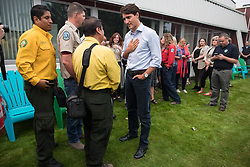Prime Minister Justin Trudeau, centre, speaks with Alfredo Nolasco, third left, Fire Handling Manager of Mexicỏۢs National Forest Commission (CONAFOR), as Miguel Campos, left, a representative of CONAFOR listens, during a visit to the Prince George Fire Centre, in Prince George, B.C., on Thursday August 23, 2018. Photo by Darryl Dyck/CP/ABACAPRESS.COM