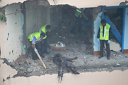 August 15, 2017 - Dhaka, Bangladesh - Police's crime scene investigators collecting evidence after a terror suspect set off a blast killing himself inside a room of the Hotel Olio International in Dhaka, Bangladesh. A suspected militant was killed in a suicide blast during a raid on a hotel in Dhaka on Tuesday. Islamist Militant Saiful Islam blew himself up during the raid despite repeated requests to surrender. The law enforcement agencies cordoned off Hotel Olio International. A portion of the hotel's fourth story reportedly collapsed and fell onto the road after the explosion causing injuries.  (Credit Image: © Suvra Kanti Das via ZUMA Wire)