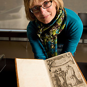 Luise Poulton, Rare Books Manager Special Collections  holds a copy of Galileo Galilei's Dialogo that survived the Inquisition in the rare book collection at the J. Willard Marriott Library on the campus of the University of Utah in Salt Lake City, Utah Wednesday Oct. 10, 2012. (Photo by August Miller).