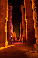 Illuminated columns and obelisk, Karnak Temple, Luxor, Egypt