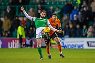 Adam Jackson (#18) of Hibernian FC clears the ball ahead of Osman Sow (#9) of Dundee United FC during the William Hill Scottish Cup fourth round match between Hibernian FC and Dundee United FC at Easter Road Stadium, Edinburgh, Scotland on 28 January 2020.