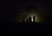 The harvest moon rises above the The Eightercua Stone Row, a Megalithic tomb with four stones aligned with the September Solstice outside Waterville in County Kerry, Ireland.<br /> Photo Don MacMonagle