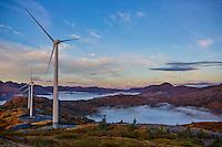 Setting full moon and wind turbines with low fog patches, Pillar Mountain, Kodiak, Alaska, fall