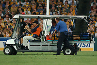 Photo: Steve Holland.<br />New Zealand v Australia. Semi-Final, at the Telstra Stadium, Sydney. RWC 2003. 15/11/2003. <br />Ben Darwin is stretchered off after a serious injury.
