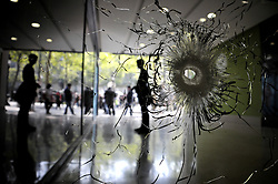 Bullet holes are seen in a window near to Marks and Spencer department store on the Champs-Elysees in Paris, France, on April 21 2017, following yesterday's shooting of a police officer. One police officer was killed and another wounded in a shooting on Paris's Champs Elysees, police said just days ahead of France's presidential election. France's interior ministry said the attacker was killed in the incident on the world famous boulevard that is popular with tourists. Photo by Alain Apaydin/ABACAPRESS.COM