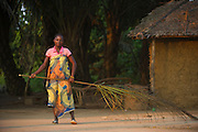 Woman sweeping with palm leaf<br /> Republic of Congo (Congo - Brazzaville)<br /> AFRICA