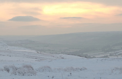 © Licensed to London News Pictures. <br /> 27/12/2014. <br /> <br /> Castleton, United Kingdom.<br /> <br /> Looking out towards Pickering from the North Yorkshire Moors after overnight snowfall caused disruption in some parts of the country.<br /> <br /> Photo credit : Ian Forsyth/LNP