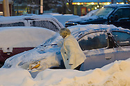 Middletown, New York -  A woman brushes show off her car during a snowstorm on Dec. 17. 2013.