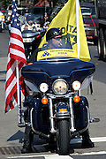 Members of the Patriot Guard Riders arriving to the Bedsford Central Presbyterian church on their bike, to honour LCpl. Nicholas J. Whyte, whose funeral is to be held today in Brooklyn, New York, NY., on Friday, June 30, 2006. LCpl. Nicholas J. Whyte, a 21-year-old American serviceman died  on June 21, 2006, while conducting combat operations in Al Anbar province, Iraq. The Patriot Guard Riders is a diverse amalgamation of riders from across the United States of America. Besides a passion for motorcycling, they all have in common an unwavering respect for those who risk their lives for the country's freedom and security. They are an American patriotic group, mainly but not only, composed by veterans from all over the United States. They work in unison, calling upon tens of different motorcycle groups, connected by an internet-based web where each of them can find out where and when a 'Mission' is called upon, and have the chance to take part. This way, the Patriot Guard Riders can cover the whole of the United States without having to ride from town to town but, by organising into different State Groups, each with its own State Captain, they are still able to maintain strictly firm guidelines, and to honour the same basic principles that moves the group from the its inception. The main aim of the Patriot Guard Riders is to attend the funeral services of fallen American servicemen, defined as 'Heroes' by the group,  as invited guests of the family. These so-called 'Missions' they undertake have two basic objectives in particular: to show their sincere respect for the US 'Fallen Heroes', their families, and their communities, and to shield the mourners from interruptions created by any group of protestors. Additionally the Patriot Guard Riders provide support to the veteran community and their families, in collaboration with the other veteran service organizations already working in the field.   **ITALY OUT**