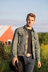 young cowboy on a farm