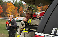 Gilford Fire Chief Steve Carrier relays information with Captain Mike Balcom during controlled burn exercises inside the Phelps Barn at Gunstock Saturday afternoon.  (Karen Bobotas Photo/for The Laconia Daily Sun)