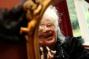Jenny, 62, the extravagant wife of Colin, the Vampyre Master, portrayed at her make-up table in her bedroom on Sunday, 29 June, 2007, in South London, England. The Vampyre Connexion is the largest and most active of all the vampire groups in the United Kingdom, counting more than 100 members that for years have gathered regularly in London to share their common love for vampires and the Dark side of life. The Connexion raised from the hashes of the Vampyre Society, the first vampire appreciation group in 1995. The group believe in the fantasy of vampires and such creatures and live it to the full. Its  roots are to be found in the legends of Bram Stokerís Dracula. The group prints its own magazine, ëDark Nightsí featuring drawings, poetry, stories, photography and events. All of the members dress very peculiar clothing, and this is a very important part of the life of the group; it is respected with pride, taste and accuracy for the detail. Most like to dress to be elegant in a range of styles from regency to Victorian, some sew their own. In addition members visit art galleries, cemeteries, churches and cathedrals, attend gigs and concerts, and hold their own parties throughout the year, Halloween being the biggest and scariest one. Membership is open to all, the only qualification: being a love of all things Vampyric. **ItalyOut**