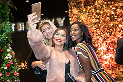 © Licensed to London News Pictures . 23/11/2018. Manchester , UK . Tisha Merry and Victoria Ekanoye pose for selfies as they arrive at an opening event of The Ivy restaurant and bar venue in Spinningfields in Manchester City Centre . Photo credit : Joel Goodman/LNP