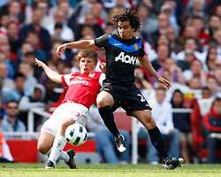 01.05.2011, Emirates Stadium, London, ENG, PL, Arsenal vs Manchester United, im Bild Fabio of Manchester United takes on Arsenal's Andrei Arshavin .Barclays Premier League.Arsenal v Manchester United.at Emirates Stadium, London on 01/05/2011, EXPA Pictures © 2011, PhotoCredit: EXPA/ IPS/ Kieran Galvin *** ATTENTION *** UK AND FRANCE OUT!