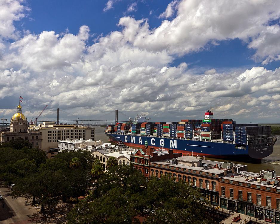 The 14,000 TEU container ship CMA CGM Theodore Roosevelt sails up river past Historic River Street to the Port of Savannah, Friday, Sept., 1, 2017, Savannah, Ga.  (GPA Photo/Stephen Morton)
