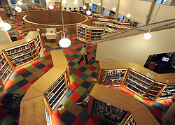 © Licensed to London News Pictures. 21/11/2011, London, UK. The main interior of the library. London's Southwark Council previews Canada Water Library its new 'super library', featuring a 150-seat theatre, restaurant and cafe, evening class space community meeting rooms and Tube station entrance and exit. The building opens to the public on November 28. Photo credit : Stephen Simpson/LNP