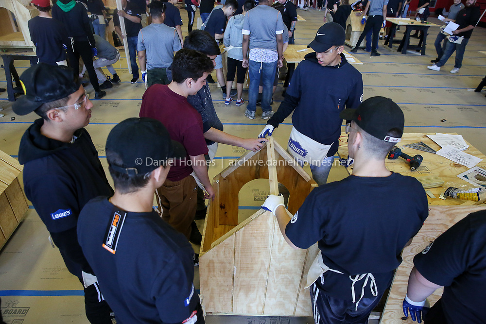 (4/25/19, MILFORD, MA) Students work to build a dog house during the skilled trades program at Milford High School on Thursday. [Daily News and Wicked Local Photo/Dan Holmes]