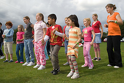 Group of children taking part in a Superhero workout at a Parklife summer activities event,