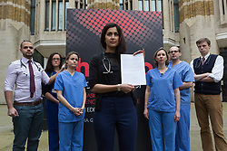 © Licensed to London News Pictures. 21/01/2016. London, UK. Dr Nadia Masood with other junior doctors and senior academics deliver a letter to Jeremy Hunt at the Department of Health calling for him to stop using misleading statistics for political gain. Photo credit : Vickie Flores/LNP