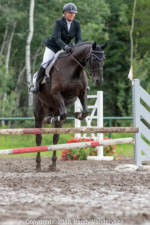 photo Randy Vanderveen<br /> County of Grande Prairie, Alberta<br /> 2018-09-01<br />  Jackie Kessler and Amadeus II clears a jump in the show jumping event Saturday afternoon at the South Peace Horse Club's Trials Saturday
