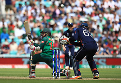 Bangladesh's Mushfiqur Rahim hits over England's wicket keeper Jos Buttler during the ICC Champions Trophy, Group A match at The Oval, London.