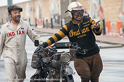 Shinya Kimura of Japan helps teammate and co-rider Yoshimasa Niimi of Japan get their 1915 Indian to the parking area after crossing the finish line in Cape Girardeau during the Motorcycle Cannonball Race of the Century. Stage-5 from Bloomington, IN to Cape Girardeau, MO. USA. Wednesday September 14, 2016. Photography ©2016 Michael Lichter.