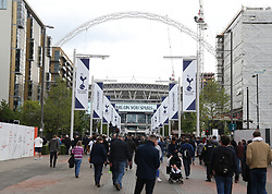 Fans make their way to the stadium prior to the match