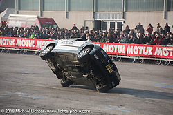 Stunt cars ride 2-wheels for a performance during Motor Bike Expo. Verona, Italy. January 24, 2016.  Photography ©2016 Michael Lichter.