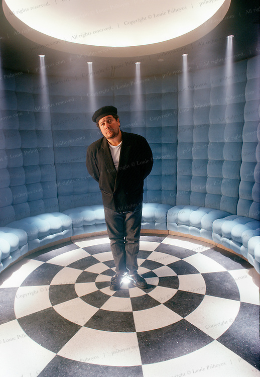 Parisian designer, Philippe Starke in the Blue Room of the Royalton Hotel in Manhattan, an Ian Schrager Hotel he designed.