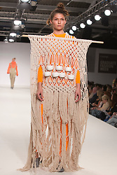 © Licensed to London News Pictures. 01/06/2014. London, England. Collection by Brooke Grindlay from UCA Epsom Fashion - university for the creative arts. Graduate Fashion Week 2014, Runway Show at the Old Truman Brewery in London, United Kingdom. Photo credit: Bettina Strenske/LNP