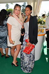 Left to right, GABBY WICKHAM and TOLULA ADEYEMI at the Summer Solstice Party during the Boodles Tennis event hosted by Beulah London and Taylor Morris at Stoke Park, Park Road, Stoke Poges, Buckinghamshire on 21st June 2014.