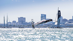 WMRT Chicago Match Cup, Chicago Yacht Club, Chicago, IL. 29th September 2017. Sam Gilmour skipper of Neptune Racing capsizes off the finish line.