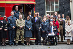 © licensed to London News Pictures. London, UK 07/11/2013. Prime Minister David Cameron welcoming members of the armed forces, The Poppy Girls and supporters of the Poppy Appeal to Downing Street. Photo credit: Tolga Akmen/LNP